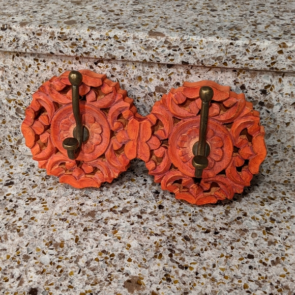 Carved wood with brass hook decor